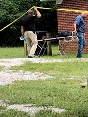 Officials work the scene of a fatal shooting at West Ripley Church of Christ on Sunday, Aug. 11, 2019, in Ripley, Miss.