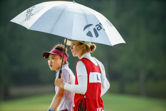 Lucy Li and her caddie on the 17th hole during the round of 16 at the 2019 U.S. Women's Amateur at Old Waverly Golf Club in West Point, Miss. on Thursday, Aug. 8, 2019.  (Copyright USGA/Steven Gibbons)