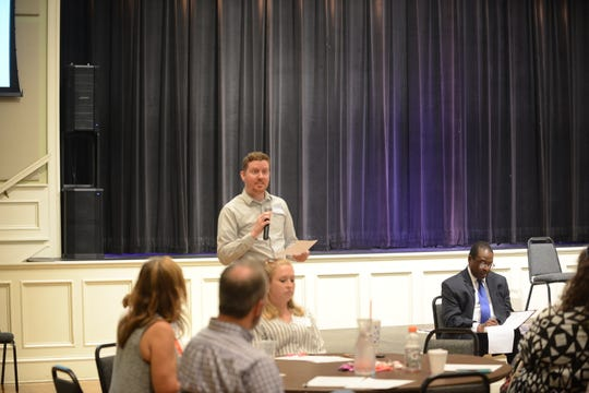 Alan Brown, a Community Montessori parent, reports what his group talked about during a parent meeting Friday.
