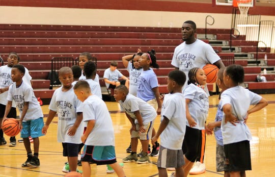 A.J. Merriweather, who is from Jackson and is currently a member of the Harlem Globetrotters organization, worked with the campers at the Bounce Back Basketball Camp at Liberty Tech on Saturday.