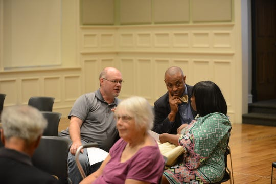 Community and board members were invited to listen at the Aug. 9 parent meeting. Pictured are county commissioner Jeff Wall, R-9, JMCSS superintendent Ray Washington and board member Janice Hampton talking as the parents talk among themsleves at the front of the room.