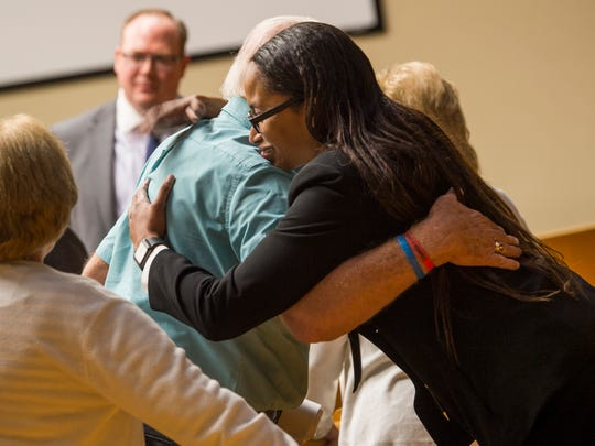 Knox County Assistant District Attorney TaKisha Fitzgerald, right, hugs Hugh Newsom, father of Christopher Newsom, after closing arguments in the trial of Eric Boyd in Knox County Criminal Court on Monday, Aug. 12, 2019.