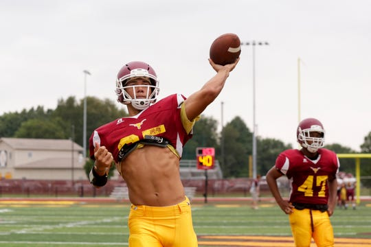 McCutcheon's Mason Douglass throws during a football practice, Monday, Aug. 12, 2019, in Lafayette.