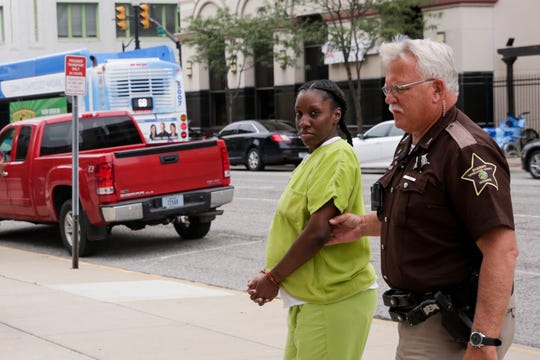 Mekeisha Roberts is escorted into the Tippecanoe County Courthouse by Sheriff's deputies to appear before Superior 2 Judge Steven Meyer, Monday, Aug. 12, 2019 in Lafayette. Roberts, 27, admitted to police she was driving drunk after crashing her car, killing her boyfriend, 30 year-old Michael Creamer, and injuring passenger Tatiana Jones on May 12, 2019.