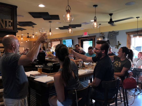 On the fourth Sunday of the month, patrons gather at Brokerage Brewing Company for the monthly Beer and Hymns sing-along.
