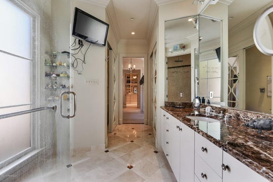 Greenbriar Estates mansion on the market for $2.5 million. The home has a lavish master suite with two walk-in closets and two master bathrooms, one featuring a steam shower.