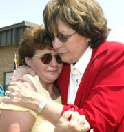 Gov. Kathleen Blanco hugs Rosalie DiCristina as she waits at the Alexandria armory for her son Chris Broussard to come home.