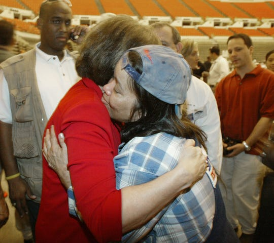 Sarah Shoemaker of Violet embraces Gov. Kathleen Blanco at the Cajundome following Hurricane Katrina in 2005.