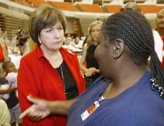 Gov. Kathleen Blanco talks with Hurricane Katrina evacuee and now Cajundome resident Joeliene West at the Cajundome Sept. 17, 2005.
