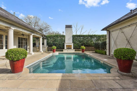 Greenbriar Estates mansion on the market for $2.5 million. The home has expansive living areas, a lavish master suite and a pool with an outside fire place.