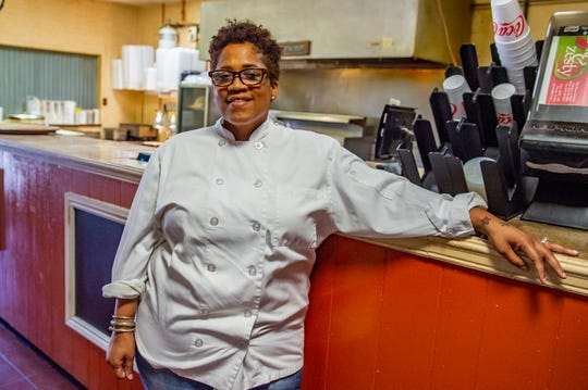 Madonna Broussard poses for a photo on at Laura's II in Lafayette. Broussard is the third generation to run the restaurant.