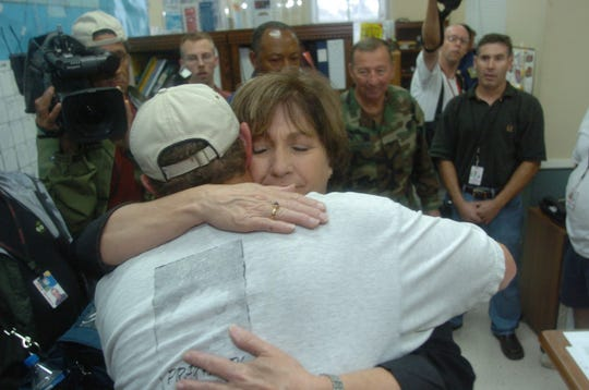 Gov. Kathleen Blanco hugs Vermilion Parish Sheriff Mike Couvillon Sept. 24, 2005, during Hurricane Rita in Abbeville.