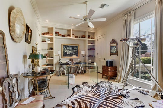 Greenbriar Estates mansion on the market for $2.5 million. This upstairs library comes with its own closet.