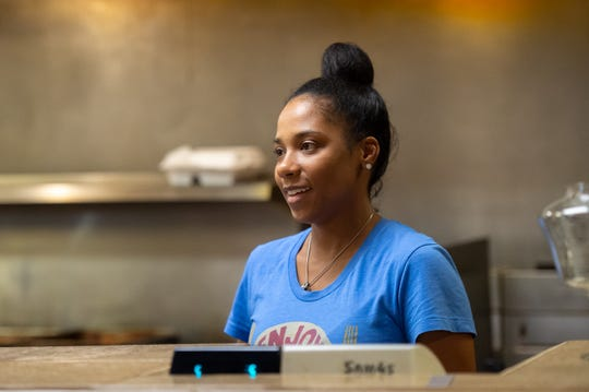 Madonna Broussard's daughter Lacey works the counter at Laura's II in Lafayette.