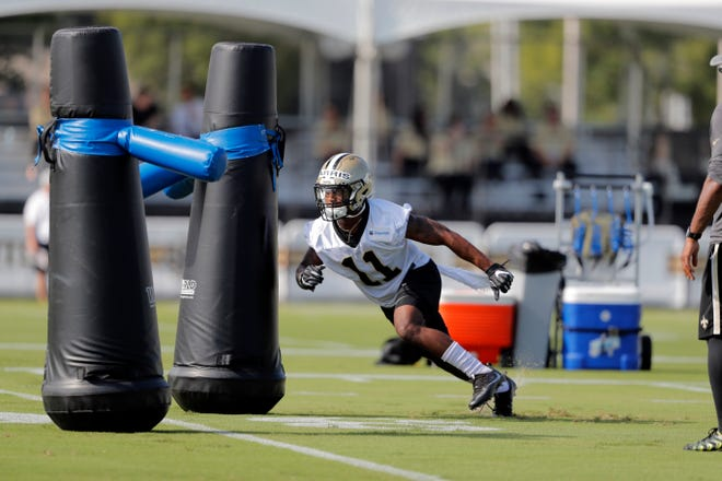 New Orleans Saints wide receiver Deonte Harris (11) runs through drills during training camp at their NFL football training facility in Metairie, La., Friday, July 26, 2019. (AP Photo/Gerald Herbert)