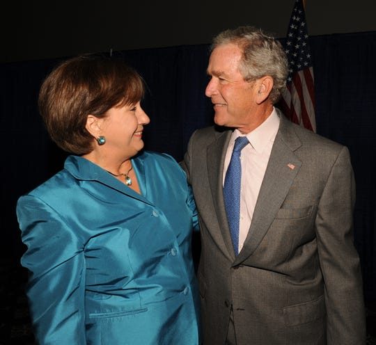Former Gov. Kathleen Blanco and President George W. Bush visit before the Acadian Ambulance Paramedic Luncheon, May 24, 2011.