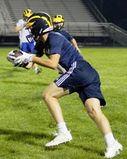 Logan Tobel hauls in an interception during Hartland's midnight practice on Monday, Aug. 12, 2019.