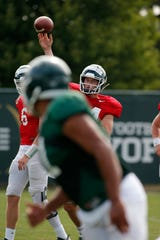 Michigan State quarterback Brian Lewerke throws a pass during an NCAA college football practice, Monday, Aug. 12, 2019, in East Lansing, Mich.