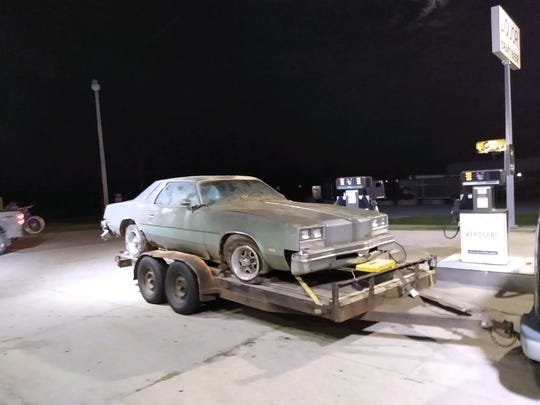 This 1977 Oldsmobile Cutlass Supreme may have the type of engine Lansing's Aaron Aikman needs to fix is Ghostbusters Ecto-1 replica car. Aikman got the car for free from a St. Johns resident.