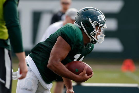 Michigan State running back Connor Heyward runs a drill during an NCAA college football practice, Monday, Aug. 12, 2019, in East Lansing, Mich.