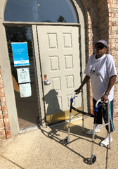 Regina D. Allen, shown outside the door of her Delta Township physical therapy office Aug. 9, 2019, wants an easier access door.