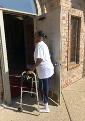 Regina D. Allen shows a friend Aug. 9, 2019, the difficulty she's had in opening the door to her physical therapy office.