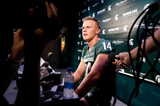 Michigan State quarterback Brian Lewerke talks with reporters during media day Aug. 5, 2019, in East Lansing.
