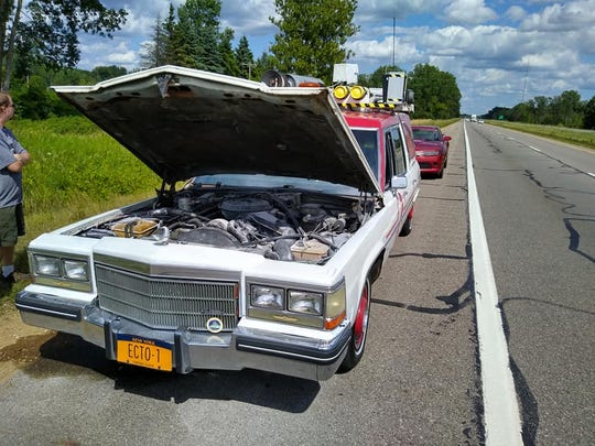 "This ""Ghostbusters"" Ecto-1 replica car stalled Sunday on Interstate 96, about a mile from Martin Luther King Jr. Boulevard. Aaron Aikman, its owner, wants to rebuild it."