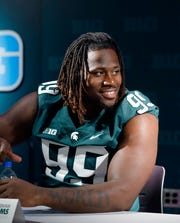 Michigan State defensive tackle Raequan Williams talks with reporters during the team's NCAA college football media day, Monday, Aug. 5, 2019, in East Lansing, Mich.