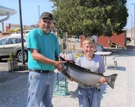 Capt. LeClair and Little Brother Mark with their winning fish.