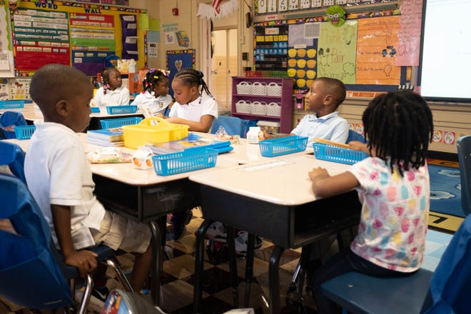 Kindergarten students sit in the classroom on their first day of school at Delano Elementary on Aug. 12, 2019.