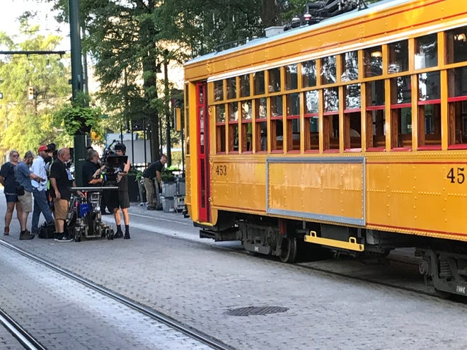 A camera crew films a trolley on the Main Street Mall in Downtown Memphis.