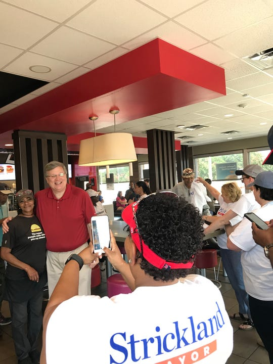 Memphis Mayor Jim Strickland poses for a picture at a Whitehaven McDonald's before door-knocking in the area.
