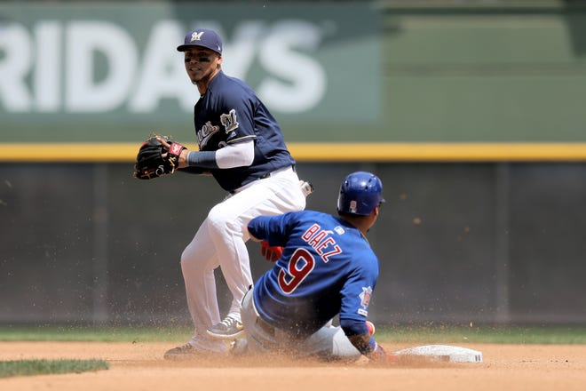The Brewers' Orlando Arcia attempts to turn a double play with the Cubs' Javier Baez out at second in a game this season at Miller Park.