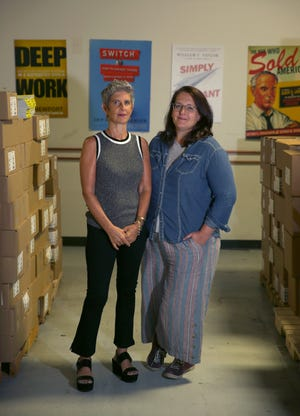 Rebecca Schwartz, left, owner and CEO of 800-CEO-READ, and General Manager Sally Haldorson are changing the name of their bulk bookseller to Porchlight Book Company.