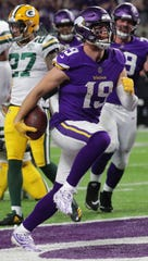 Adam Thielen scores against the Packers in a 24-17 Vikings victory at U.S. Bank Stadium last season.