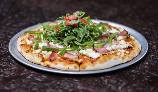 The Javier Pizza at the Precinct Tap & Table features charred pineapple, scallions, ham and goat cheese.