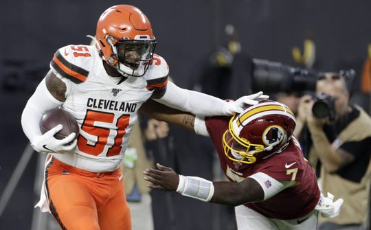 "In this Thursday, Aug. 8, 2019 file photo, Cleveland Browns linebacker Lyndell ""Mack Wilson"" (51) returns an interception for a touchdown, as Washington Redskins quarterback Dwayne Haskins (7) reaches for him during the first half of an NFL preseason football game in Cleveland. Proficient on social media, Wilson, a G.W. Carver graduate, has also shown a nose for the ball. The fifth-round pick from Alabama had two interceptions in his NFL preseason debut and has been impressive in camp."