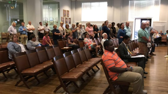Residents of a the Snowdoun community were asked to stand at a city council meeting where the showed up to protest a Latino festival in their neighborhood