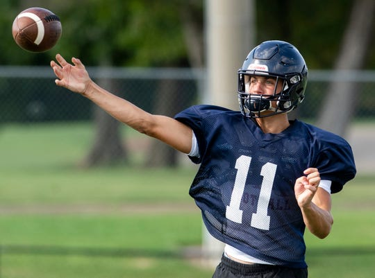 Quarterback Britton Kohn throws as Montgomery Academy holds football practice at their campus in Montgomery, Ala., on Monday August 12, 2019.