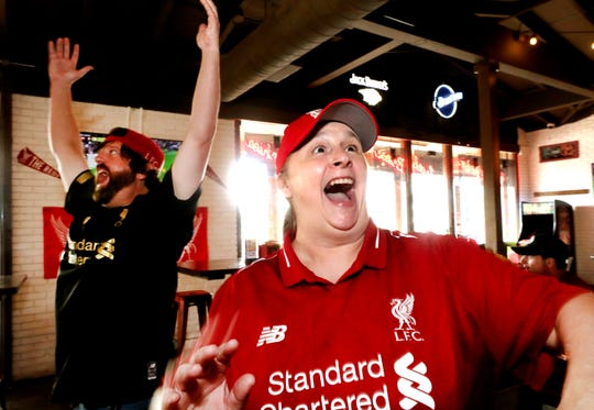 J.D. Deckard, left and Susan Kerr, both both members of Liverpool Football Club Murfreesboro TN fan club, react as Liverpool scores a goal against Norwich. The group met at the Murfreesboro Party Fowl to watch the Liverpool game on Friday Aug. 9, 2019.