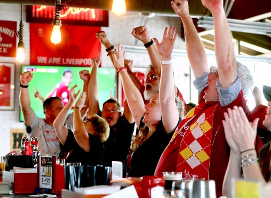Members of Liverpool Football Club Murfreesboro TN fan club all celebrate a Liverpool goal against Norwich while watching a match on television at the Murfreesboro Party Fowl on Friday Aug. 9, 2019.