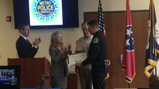 From left, U.S. Attorney for the Middle District of Tennessee Don Cochran, U.S. Sen. Marsha Blackburn and  U.S. Rep. Jim Cooper present MNPD Officer Nicholas Diamond the Congressional Badge of Bravery at the Madison Precinct on Monday, Aug. 12, 2019.