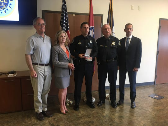 U.S. Rep. Jim Cooper, U.S. Sen. Marsha Blackburn, MNPD Officer Nicholas Diamond, MNPD Chief Steve Anderson and U.S. Attorney for the Middle District of Tennessee Don Cochran pose after Diamond was awarded the Congressional Badge of Bravery at the Madison Precinct on Monday, Aug. 12, 2019.