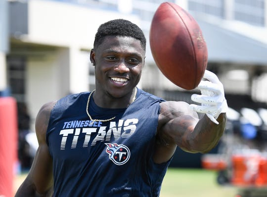 Tennessee Titans wide receiver A.J. Brown (11) catches passes off the JUGS machine after practice at Saint Thomas Sports Park on Monday, Aug. 12, 2019.