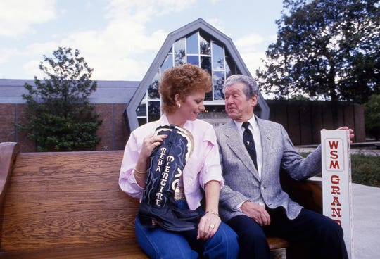 "Reba McEntire, the newest member of the Grand Ole Opry, and Roy Acuff, the king of country music, show off items that are part of the Country Music Hall of Fame and Museum's newest exhibit, ""The Grand Ole Opry: The First 60 Years,"" on April 9, 1986."