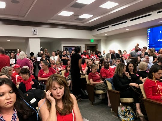 A crowd packs a legislative hearing room to hear arguments over a measure that could ban abortions in Tennessee, on Aug. 12, 2019, in Nashville.