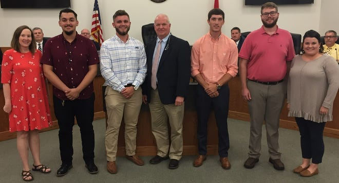 Recognized by Mayor Don L. Weiss Jr. and the Dickson City Council at the Aug. 5 council meeting were (left to right) DCHS Work-Based Learning instructor Nikki Akins, DCHS student Aurelio Rincon, CWHS student Dalton Harper, Mayor Weiss, DCHS student Grayson Cochran, DCHS student Thor Tucker, CWHS Work-Based Learning instructor Veronica Walton and (not pictured) DCHS student Austin Berry.