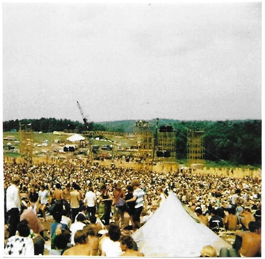 The view of the Woodstock stage that Naples resident Casey Wolff shot in 1969.