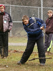 "A 2016 Advocate file photos shows Braden Poling of Boy Scout Troop 4 in Newark, cracking his homemade golf club Saturday during the Licking District Klondike Derby ""The Highland Games"" at Camp Falling Rock. Scouts from Licking County held the event which includes outdoor challenges and tests of skills."